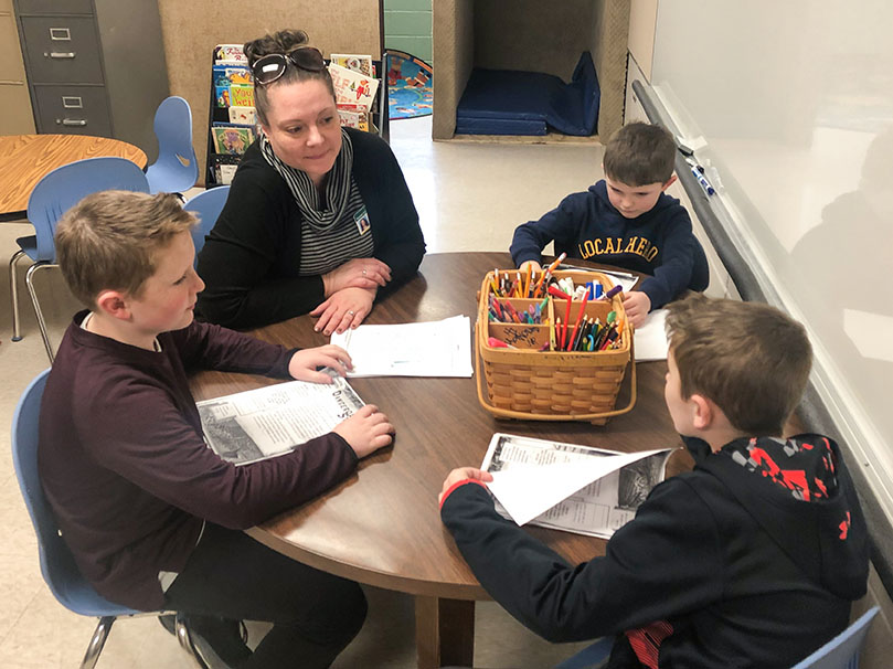 Allison Slone works with a group of students in a classroom at McBrayer Elementary School (Rowan County).