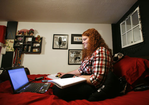 A student works on schoolwork from home.